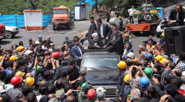 President Hassan Rouhani addresses coal miners during his visit to the site of the deadly explosion (Iranian Presidency Office via AP)