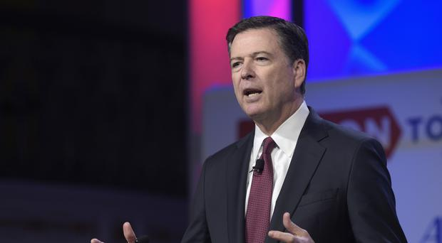 FBI Director James Comey has been fired by President Trump. (AP/Susan Walsh)