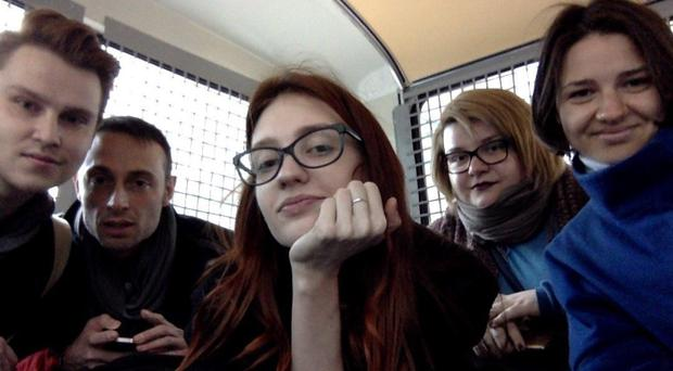 Russian activists take a selfie inside a police van after being detained in Moscow (Nikita Safronov photo via AP)