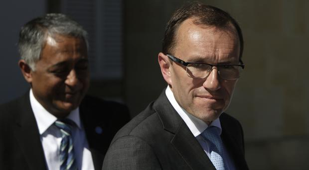 Espen Barth Eide leaves the presidential palace after a meeting with Cypriot president Nicos Anastasiades in Nicosia, Cyprus (AP)