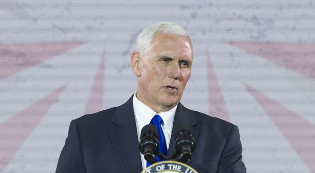 Vice President Mike Pence will lead the commission, officials said (AP)