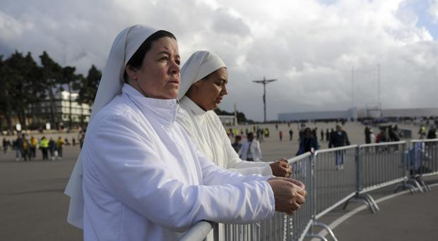 Two nuns attend a mass at the Chapel of the Apparitions in the Fatima Sanctuary (AP)