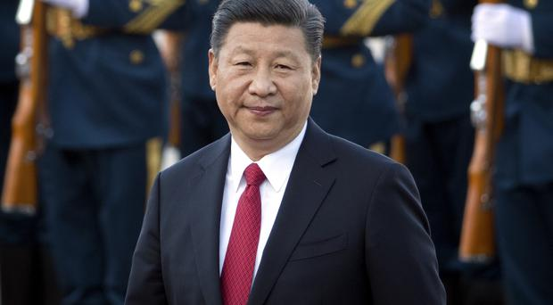 Xi Jinping has plans for a vast network of ports, railways and roads expanding China's trade with Asia, Africa and Europe (AP)