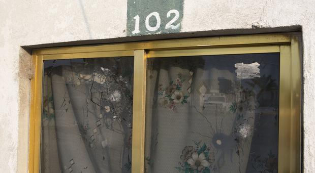 Bullet holes near the scene of the alleged killing