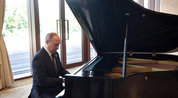 Russian President Vladimir Putin plays piano before his talks with Chinese President Xi Jinping prior to the opening ceremony of the Belt and Road Forum in Beijing, Sunday, May 14, 2017. (Alexei Nikolsky, Sputnik, Kremlin Pool Photo via AP)