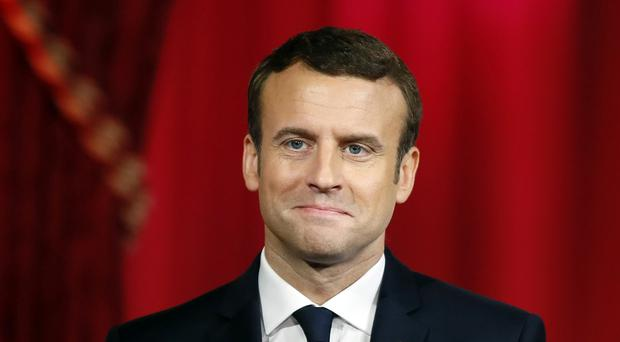 Macron delays naming ministers to check taxes