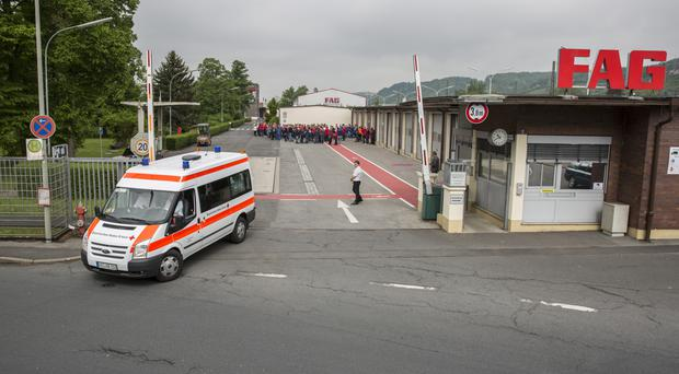 An ambulance leaves FAG Schaeffler company in Eltmann, Germany. (Rene Ruprecht/dpa/AP)