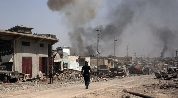 Iraqi special forces are battling IS militants in Mosul (AP)