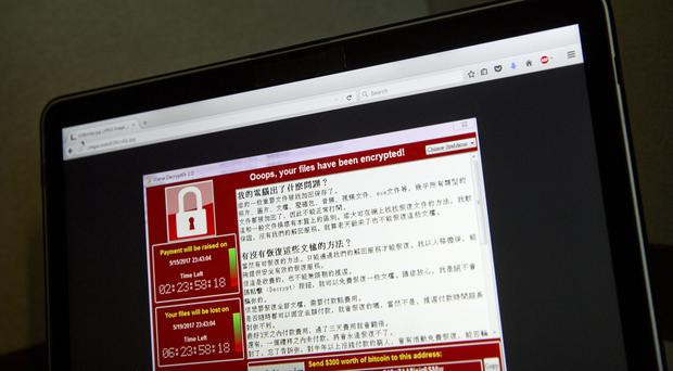 WannaCry encrypts victims' computer files and displays a message demanding ransoms to be paid in the digital currency Bitcoin (AP)