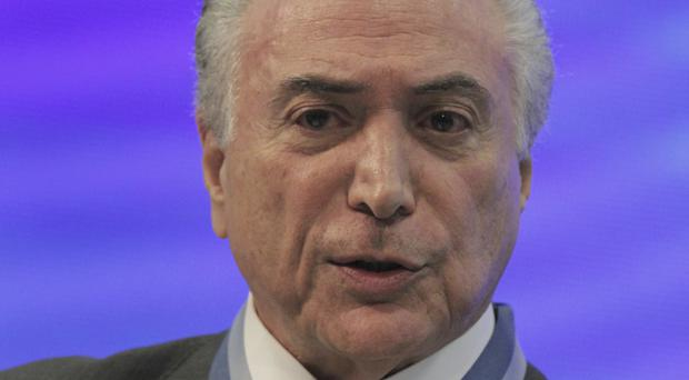 Brazil's President Temer 'taped agreeing £120m in bribes'