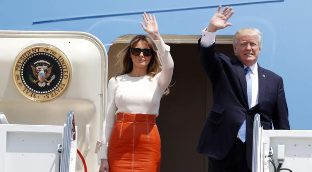 President Donald Trump and first lady Melania Trump wave as they board Air Force One prior to his departure on his first overseas trip (AP)