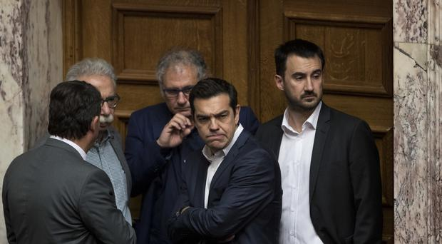 Greece's prime minister Alexis Tsipras has been in conversation with French president Emmanuel Macron over a new deal (AP)