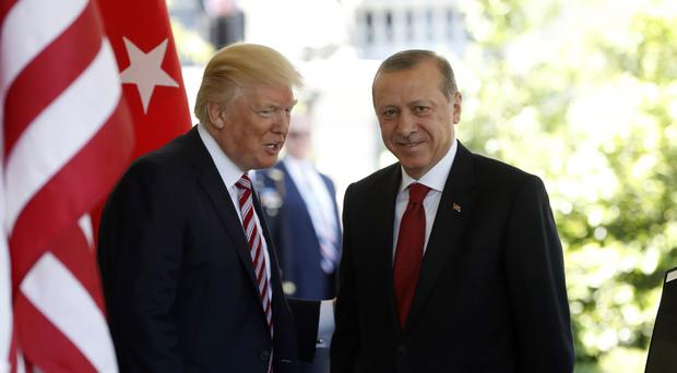 The Trump administration faced growing calls for a forceful response to violence by Turkish presidential guards on American soil (AP)