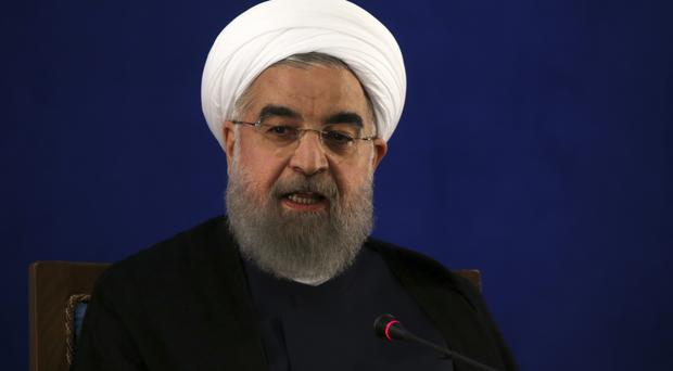Rouhani vows to continue ballistic missile program