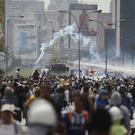 Security forces spray demonstrators with water cannons during an anti-government protest in Caracas (AP)