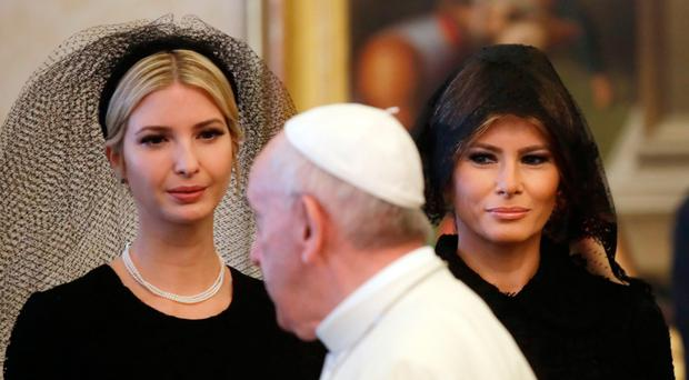 Pope Francis meets US First Lady Melania Trump (right) and Ivanka Trump, the daughter of American President Donald Trump at the Vatican yesterday