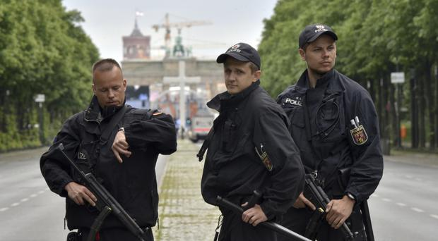 German police guarding the Brandenburg Gate in Berlin (AP)