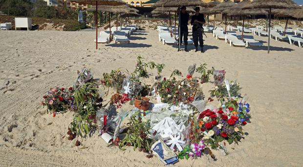 A total of 38 people lost their lives after a gunman stormed the beach