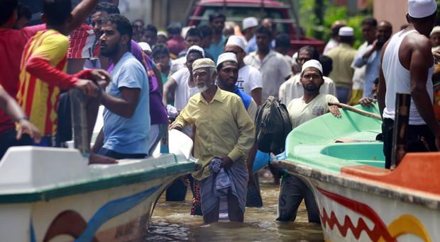 Stranded Sri Lankan flood victims wait to be evacuated (AP Photo/Eranga Jayawardena)