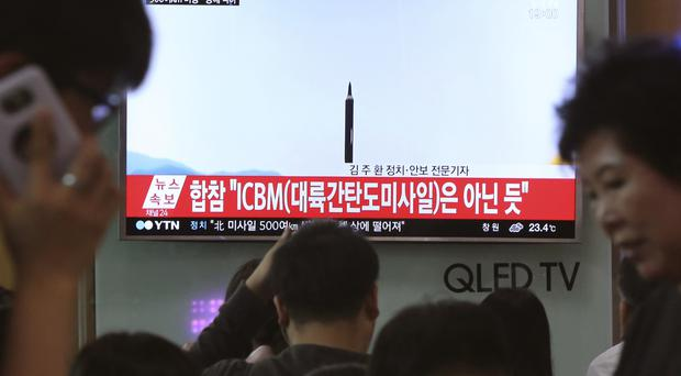 People at Seoul railway station watch a TV news programme last week showing a file image of a missile launch conducted by North Korea (AP Photo/Ahn Young-joon, File)