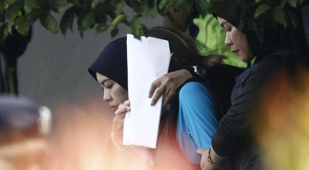 Vietnamese suspect Doan Thi Huong, left, is escorted by police from court (AP)