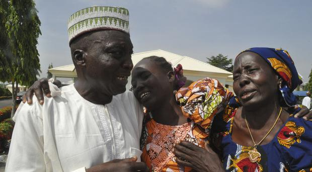 Family members celebrate with one of the released schoolgirls in Abuja, Nigeria (Olamikan Gbemiga/AP)