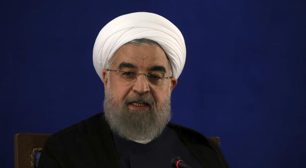 Iranian president Hassan Rouhani has secured another term in office (Vahid Salemi/AP)