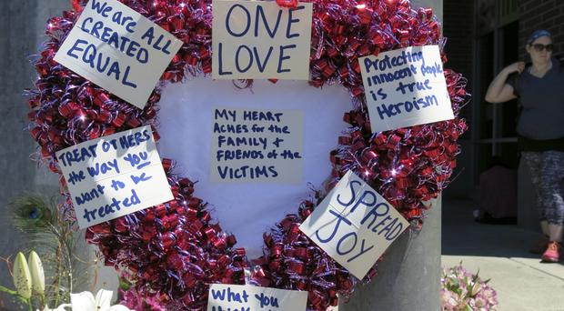 Tributes left for the victims in Portland, Oregon (Gillian Flaccus/AP)