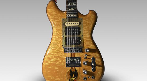 Jerry Garcia's famous 'Wolf' guitar was sold for more than £1.5m (Guernsey's/AP)