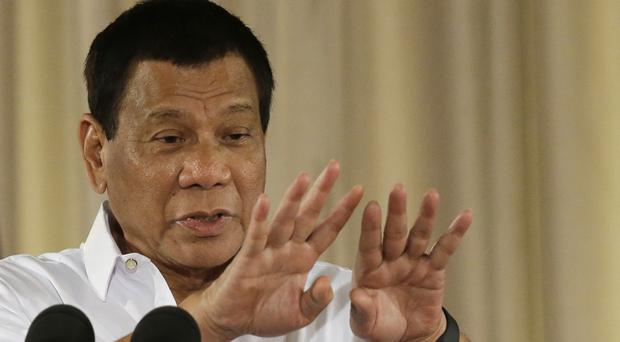 Mr Duterte has imposed martial law in some areas in a bid to tackle Islamic extremists (AP)