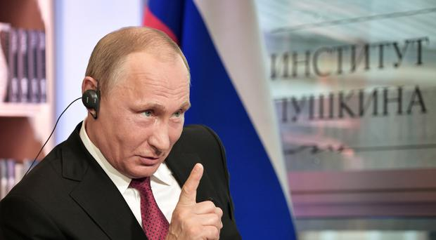 Mr Putin also insisted that hackers could not affect elections in other countries (AP)