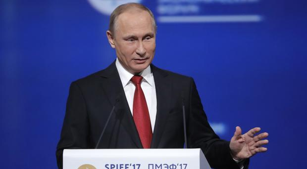 Vladimir Putin addresses the St Petersburg International Economic Forum in Russia (Tass News Agency/AP)