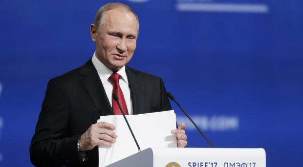 Vladimir Putin compared the US focus on alleged Russian interference to anti-Semitism (AP)