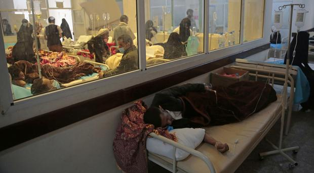 People are treated for suspected cholera infection at a hospital in Sanaa (Hani Mohammed/AP)