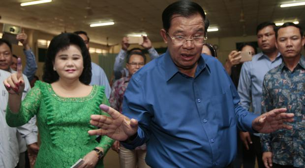Cambodian Prime Minister Hun Sen, of the Cambodian People's Party, with his wife, Bun Rany, left, at Takhmua polling station in Kandal province, south-east of Phnom Penh (AP Photo/Heng Sinith)