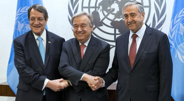 UN secretary general Antonio Guterres, centre, shakes hands with Cypriot president Nicos Anastasiades, left, and Turkish Cypriot leader Mustafa Akinci at the United Nations headquarters (AP)