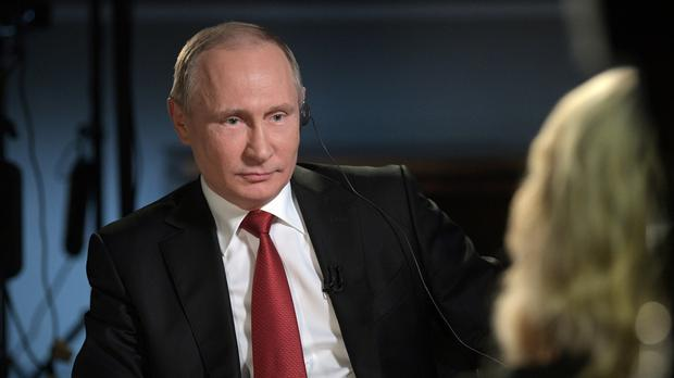 Vladimir Putin says claims about Russian involvement in US elections are untrue (AP)