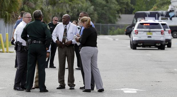 Authorities at the scene of the shooting in Orlando, Florida (AP/John Raoux)