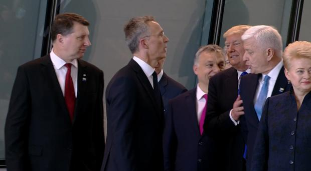 Montenegro Prime Minister Dusko Markovic appears to be pushed aside by US President Donald Trump as they were given a tour of Nato's new HQ in Brussels (NATO TV via AP, File)