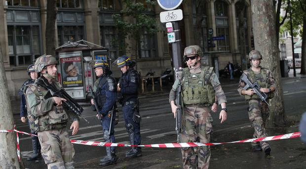 Police officers and soldiers seal off the access to Notre Dame Cathedral in Paris after a man attacked officers with a hammer (AP Photo/Christophe Ena)