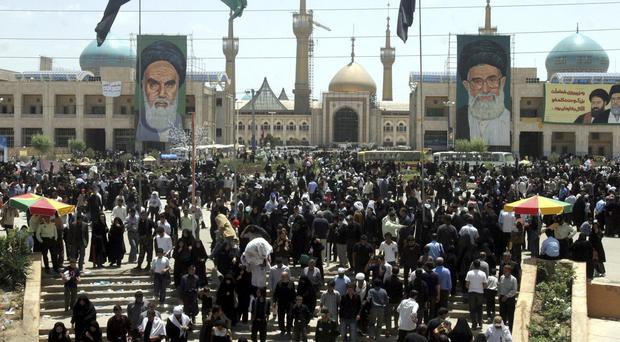 Iranians mark the anniversary of the death of Ayatollah Ruhollah Khomeini outside his shrine in Tehran (AP Photo/Hasan Sarbakhshian, File)