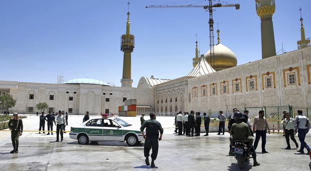 Police officers near the shrine of Ayatollah Khomeini (AP/Ebrahim Noroozi)