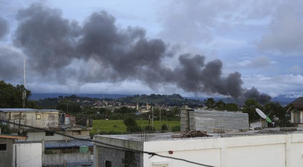 Smoke from air strikes as fighting continues in Marawi city, southern Philippines (AP/Aaron Favila)