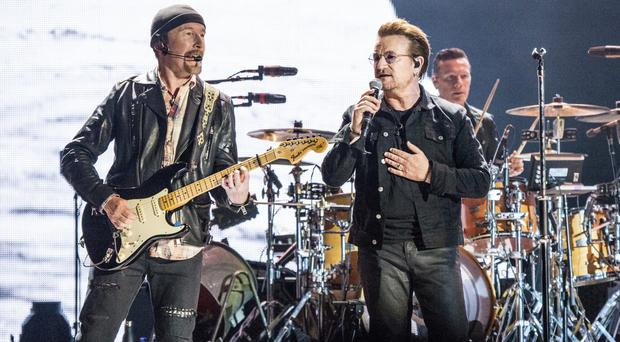 The Edge, left, and Bono of U2 perform at the Bonnaroo Music and Arts Festival (Amy Harris/Invision/AP)
