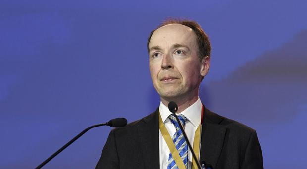 Jussi Halla-aho delivers a speech after he was elected to be new chairman of the Finns Party (Jussi Nukari/Lehtikuva via AP)