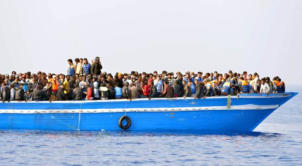 Migrants stranded on a boat off the Libyan coast