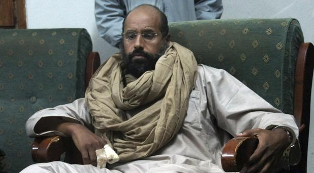 Saif al-Islam is seen after his capture in the custody of revolutionary fighters in Zintan, a town south of the capital Tripoli, Libya (AP)