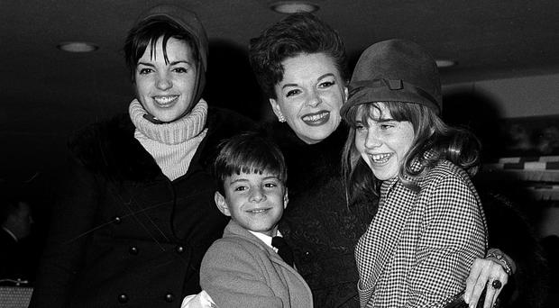 Judy Garland with her son Joseph, daughters Lorna, right, and Liza, left, in 1964 (AP)