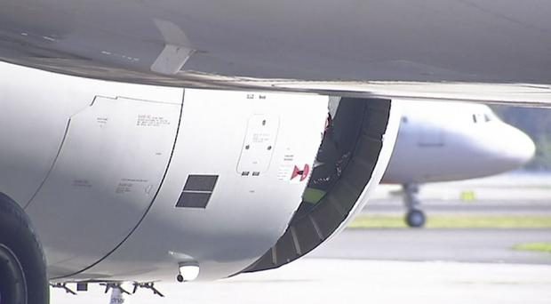 A hole is seen in the engine of China Eastern airlines Flight 736 after it landed in Sydney (Australian Broadcasting Corporation via AP)