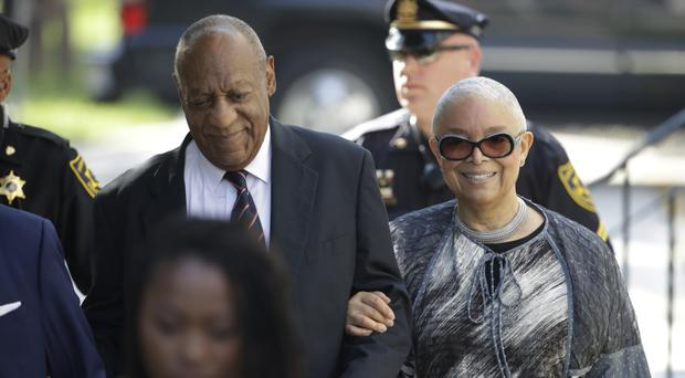 Bill Cosby arrives for his sexual assault trial with his wife Camille (AP)